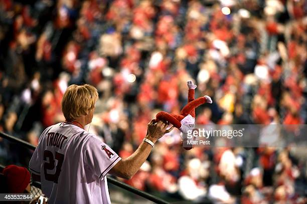 Los Angeles Angels of Anaheim fan twirls a Rally Monkey during the game against the Seattle Mariners on March 31 2014 at Angel Stadium of Anaheim in...