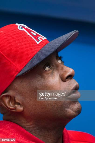 Los Angeles Angels of Anaheim infield coach Alfredo Griffin talks to a fan before the regular season MLB game between the Los Angeles Angels of...