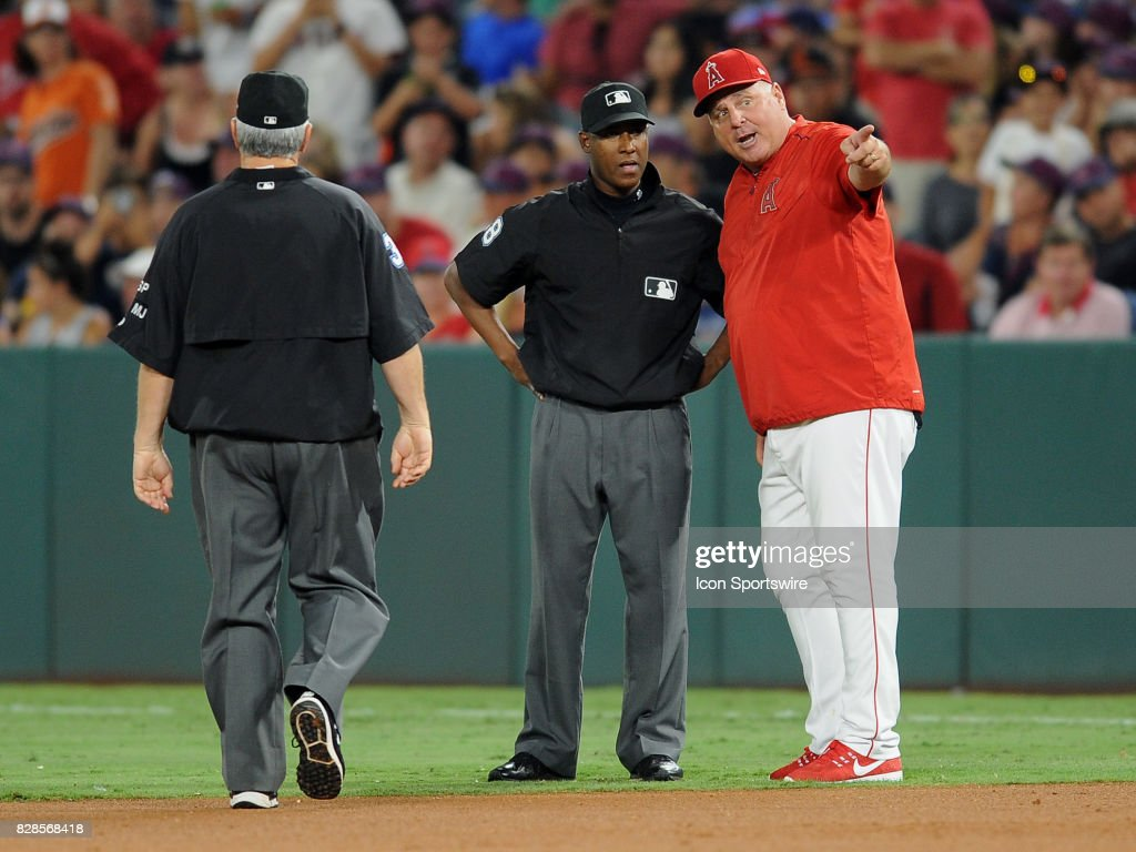 Los Angeles Angels of Anaheim manager Mike Scioscia (14) with first base umpire Ramon De Jesus (18) after Scioscia and Albert Pujols (5) were thrown out of the game in the sixth inning of a game against the Baltimore Orioles, on August 8, 2017, played at Angel Stadium of Anaheim in Anaheim, CA.