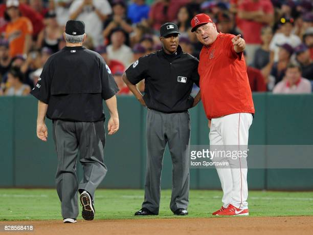 Los Angeles Angels of Anaheim manager Mike Scioscia with first base umpire Ramon De Jesus after Scioscia and Albert Pujols were thrown out of the...