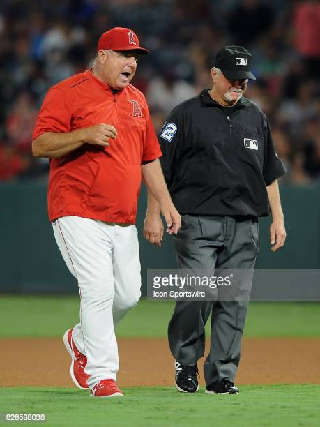 Los Angeles Angels of Anaheim manager Mike Scioscia with third base umpire Dana DeMuth after Scioscia and Albert Pujols were thrown out of the game...