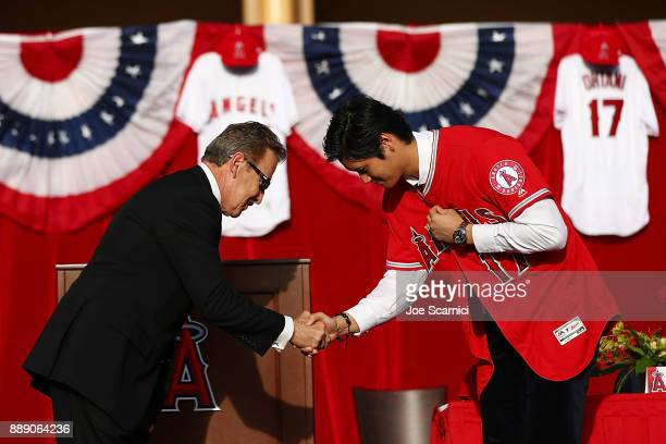 Los Angeles Angels of Anaheim owner Arte Moreno introduces Shohei Ohtani to the team at Angel Stadium of Anaheim on December 9 2017 in Anaheim...