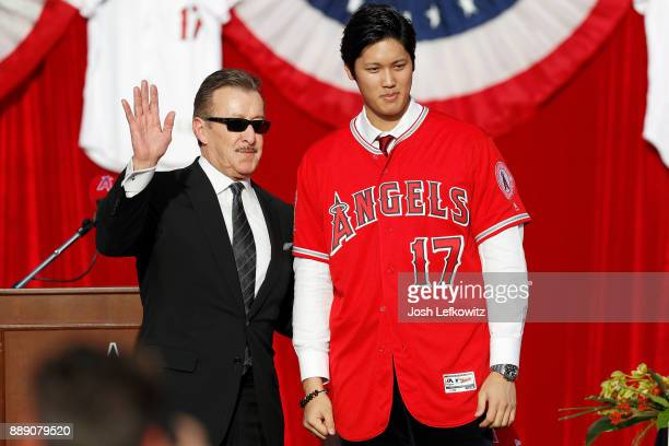 Los Angeles Angels of Anaheim owner Arte Moreno introduces Shohei Ohtani to the Los Angeles Angels of Anaheim at Angel Stadium of Anaheim on December...