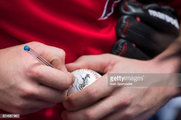 Los Angeles Angels of Anaheim Pitcher Brooks Pounders autographs a ball for a fan before the regular season MLB game between the Los Angeles Angels...
