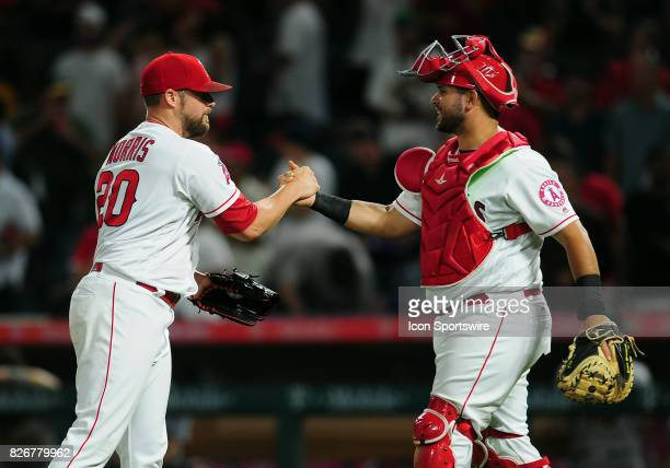 Los Angeles Angels of Anaheim pitcher Bud Norris shakes hands with catcher Juan Graterol on the field after the Angels defeated the Oakland Athletics...