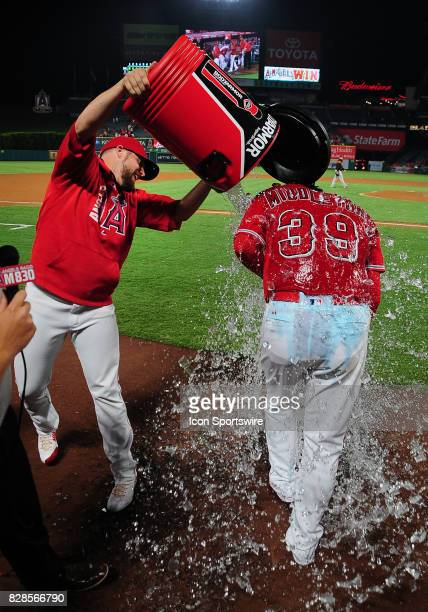 Los Angeles Angels of Anaheim pitcher Keynan Middleton is drenched by teammate Blake Parker after Middleton got his first major league save after the...