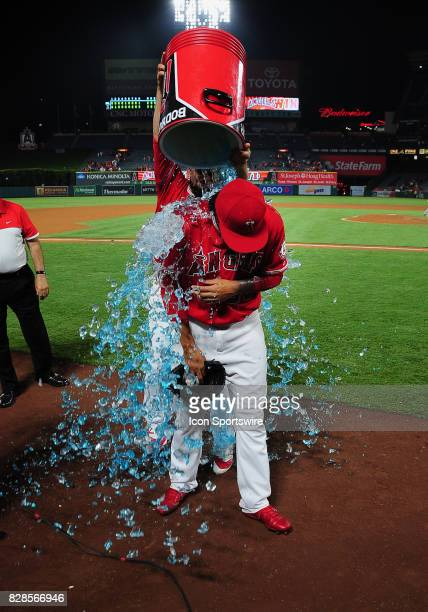 Los Angeles Angels of Anaheim pitcher Keynan Middleton is drenched by teammate Cam Bedrosian after Middleton got his first major league save after...