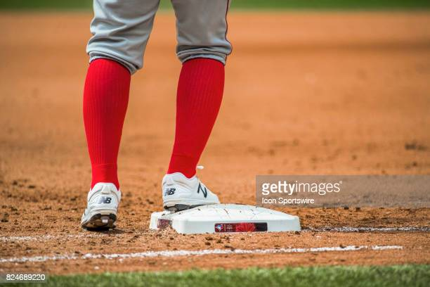 Los Angeles Angels of Anaheim player wearing traditional socks touches first base during the regular season MLB game between the Los Angeles Angels...