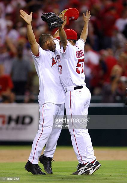 Los Angeles Angels of Anaheim reliever Francisco Rodriguez and shortstop Orlando Cabrera bump chests in celebration after 53 victory over the New...