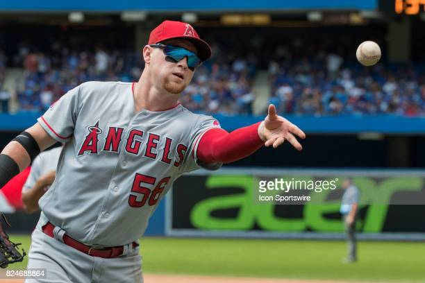 Los Angeles Angels of Anaheim Right field Kole Calhoun tosses a ball to the fans after an inning during the regular season MLB game between the Los...