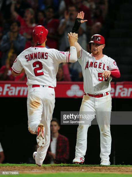 Los Angeles Angels of Anaheim shortstop Andrelton Simmons is greeted at the plate by right fielder Kole Calhoun after both scored on a hit by pinch...