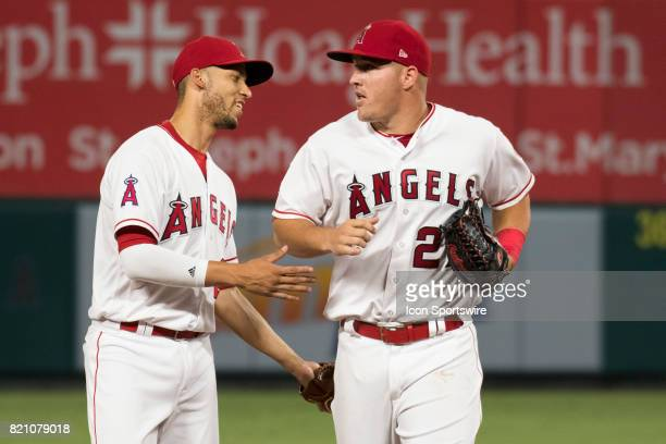 Los Angeles Angels of Anaheim shortstop Andrelton Simmons congratulates Los Angeles Angels of Anaheim center fielder Mike Trout after a great catch...