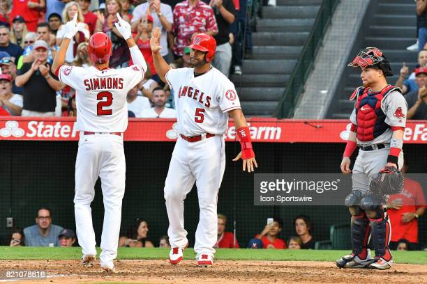 Los Angeles Angels of Anaheim Shortstop Andrelton Simmons points to the sky and is greeted by Los Angeles Angels of Anaheim Designated hitter Albert...