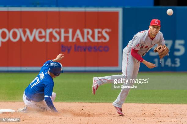 Los Angeles Angels of Anaheim Shortstop Andrelton Simmons turns a double play as Toronto Blue Jays Infielder Ryan Goins slides to second during the...