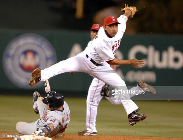 Los Angeles Angels of Anaheim shortstop Orlando Cabrera leaps over Casey Blake of the Cleveland Indians to make a throw to first base during Major...
