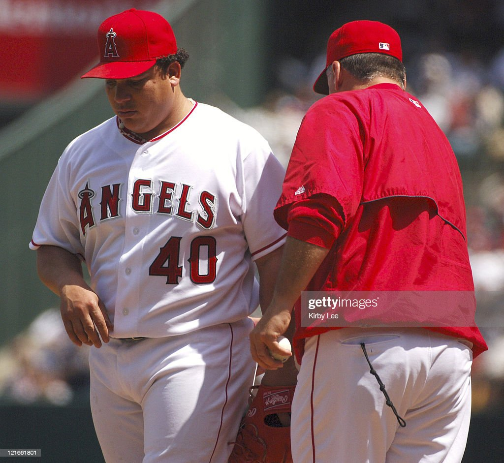 Los Angeles Angels of Anaheim starter Bartolo Colon is removed by manager Mike Scioscia in the third inning of 101 loss to the New York Yankees at...