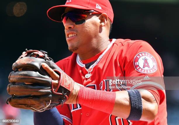 Los Angeles Angels of Anaheim Third base Yunel Escobar transfers the ball from his glove hand to his throwing hand after a nifty backhand stop during...