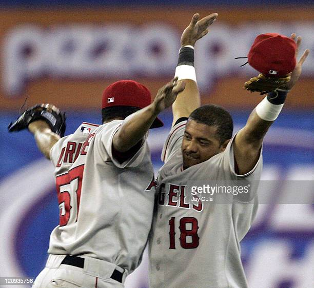 Los Angeles Angels of Anaheim's Orlando Cabrera and Francisco Rodriguez congratulate one another after the Angels 30 victory against the Toronto Blue...