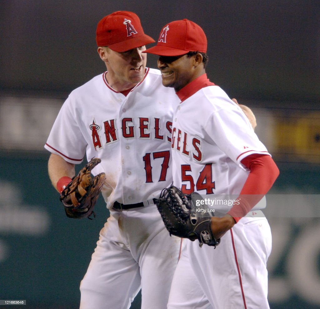 Los Angeles Angels of Anahiem starter <a gi-track='captionPersonalityLinkClicked' href=/galleries/search?phrase=Ervin+Santana&family=editorial&specificpeople=243096 ng-click='$event.stopPropagation()'>Ervin Santana</a> (right) is congratulated by <a gi-track='captionPersonalityLinkClicked' href=/galleries/search?phrase=Darin+Erstad&family=editorial&specificpeople=178264 ng-click='$event.stopPropagation()'>Darin Erstad</a> after 4-0 victory over the Chicago White Sox at Angel Stadium in Anaheim, Callifornia. on Monday, May 23, 2005. Santana (1-0) pitched a complete-game shutout for his first major league win. Santana, 22 years, 4 months and 13 days, is the youngest Angel to throw a complete game since 1989.