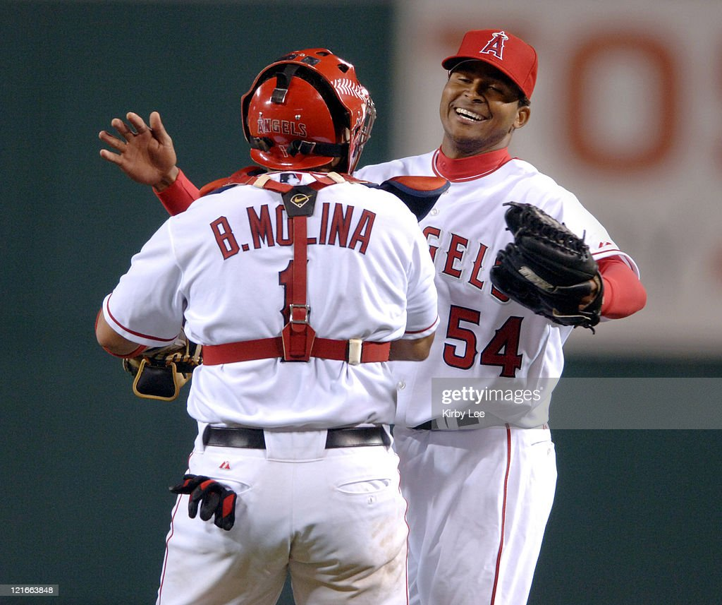 Los Angeles Angels of Anahiem starter <a gi-track='captionPersonalityLinkClicked' href=/galleries/search?phrase=Ervin+Santana&family=editorial&specificpeople=243096 ng-click='$event.stopPropagation()'>Ervin Santana</a> is congratulated by catcher <a gi-track='captionPersonalityLinkClicked' href=/galleries/search?phrase=Bengie+Molina&family=editorial&specificpeople=167095 ng-click='$event.stopPropagation()'>Bengie Molina</a> after 4-0 victory over the Chicago White Sox at Angel Stadium in Anaheim, Callifornia. on Monday, May 23, 2005. Santana (1-0) pitched a complete-game shutout for his first major league win. Santana, 22 years, 4 months and 13 days, is the youngest Angel to throw a complete game since 1989.