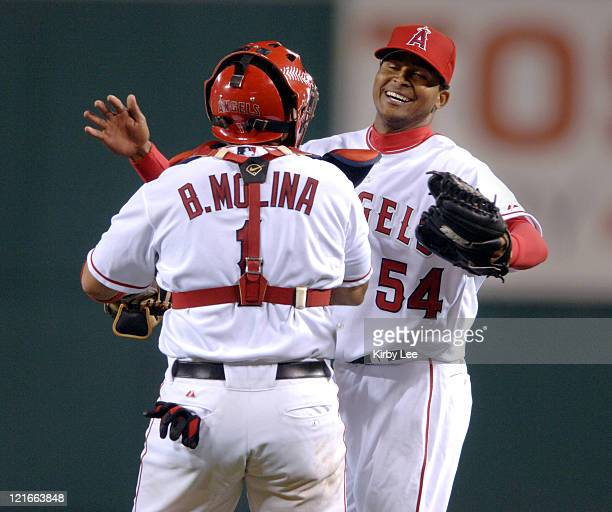 Los Angeles Angels of Anahiem starter Ervin Santana is congratulated by catcher Bengie Molina after 40 victory over the Chicago White Sox at Angel...