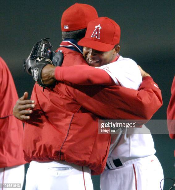 Los Angeles Angels of Anahiem starter Ervin Santana is embraced by pitching coach Bud Black after 40 victory over the Chicago White Sox at Angel...