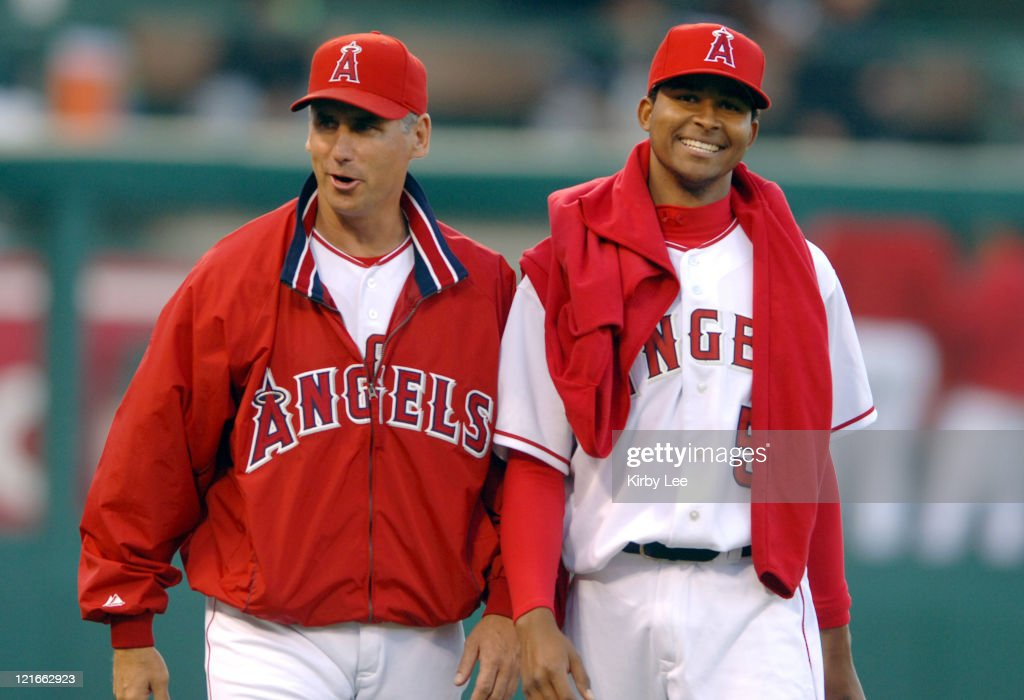 Los Angeles Angels of Anahiem starter <a gi-track='captionPersonalityLinkClicked' href=/galleries/search?phrase=Ervin+Santana&family=editorial&specificpeople=243096 ng-click='$event.stopPropagation()'>Ervin Santana</a> (right) walks onto the field with pitching coach Bud Black before 4-0 victory over the Chicago White Sox at Angel Stadium in Anaheim, Callifornia. on Monday, May 23, 2005. Santana (1-0) pitched a complete-game shutout for his first major league win. Santana, 22 years, 4 months and 13 days, is the youngest Angel to throw a complete game since 1989.