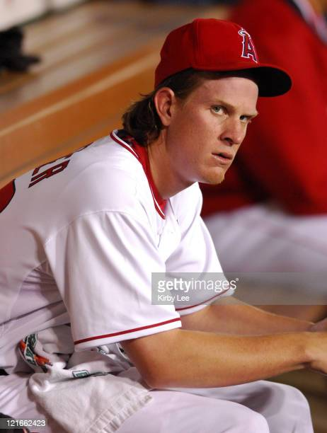 Los Angeles Angels of Anahiem starter Jered Weaver sits dejectedly in the dugout after being removed in the second inning of Major League Baseball...