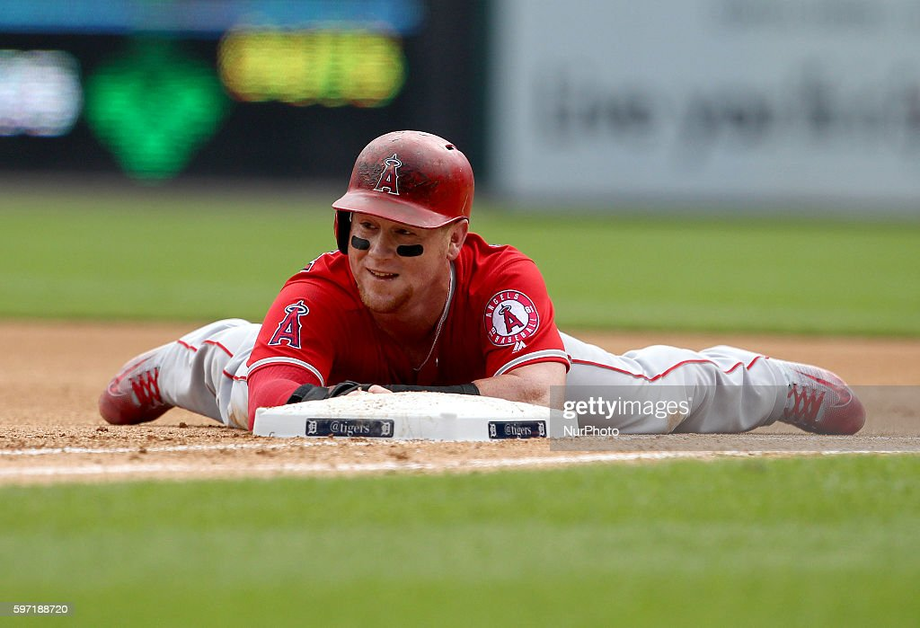 Los Angeles Angels right fielder Kole Calhoun is tagged out at first on a steal attempt to second base during the fourth inning of a baseball game...