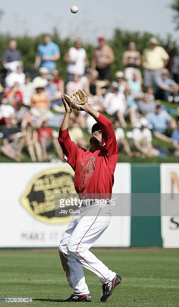 Los Angeles Angels SS Orlando Cabrera settles under an infield popup in Cactus League action vs the Seattle Mariners at Tempe Diablo Stadium in Tempe...