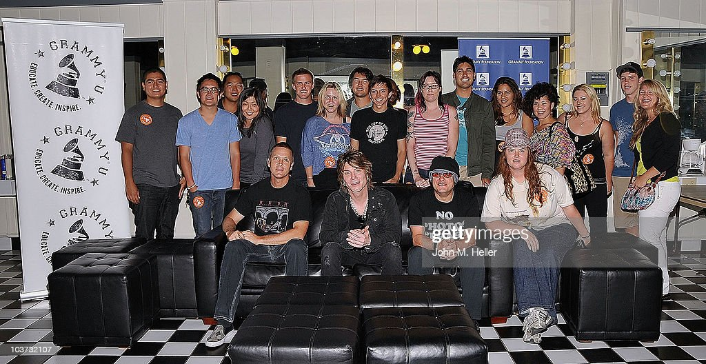Los Angeles area high school and college students attend the Grammy Foundation's sound check and Q and A with the Goo Goo Dolls Front Row (L-R) Drums <a gi-track='captionPersonalityLinkClicked' href=/galleries/search?phrase=Mike+Malinin&family=editorial&specificpeople=883519 ng-click='$event.stopPropagation()'>Mike Malinin</a>, Lead Vocals and Guitar Jon Rzeznik and Bass Guitar <a gi-track='captionPersonalityLinkClicked' href=/galleries/search?phrase=Robby+Takac&family=editorial&specificpeople=778886 ng-click='$event.stopPropagation()'>Robby Takac</a> at the Greek Theater on August 29, 2010 in Los Angeles, California.