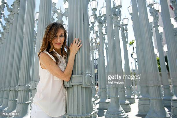 Los Angeles based author Francesca Lia Block is photographed next to an art installation by artist Chris Burden titled 'Urban Light' consisting of...