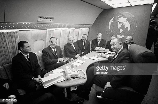 President Lyndon Johnson confers with VicePresident Hubert Humphrey cabinet members aboard Air Force One LR Robert McNamara Sec Defense Humphrey Dean...