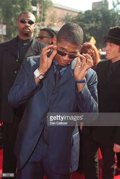 02/2499 Los Angeles CA Usher arrive's at the 'Grammy Awards' held in Los Angeles at the Shrine Auditorium