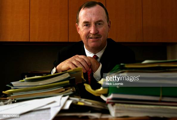 Los Angeles Ca––George McCrimlisk a personal financial planner for KPMG sits at his desk stacked high with folders as the tax deadline approaches