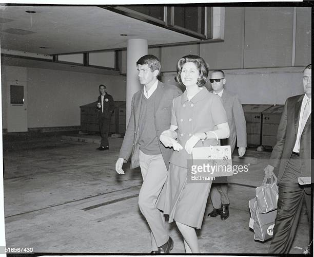 Los Angeles California Actor George Hamilton and Lynda Bird Johnson leave International Airport March 17 after the actor met Miss Johnson's plane...