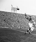Los Angeles California Snaring A Pass Elroy 'Crazy Legs' Hirsch Los Angeles Rams' end reaches to snare a pass on the Cleveland Browns' 37 yard line...