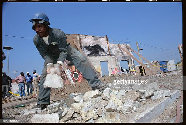 Los Angeles California South Central LA Southern Black Carpenters Association demolishes site of thrifty store burned on first night of riots