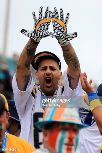 Los Angeles Chargers fan cheers during the first half of a game against the Miami Dolphins at StubHub Center on September 17 2017 in Carson California