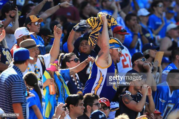 Los Angeles Chargers fans cheer during the second half of a game against the Kansas City Chiefs at StubHub Center on September 24 2017 in Carson...