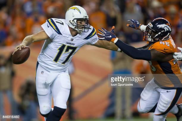Los Angeles Chargers quarterback Philip Rivers fends off Denver Broncos linebacker Shaquill Barrett during the Los Angeles Chargers vs Denver Broncos...