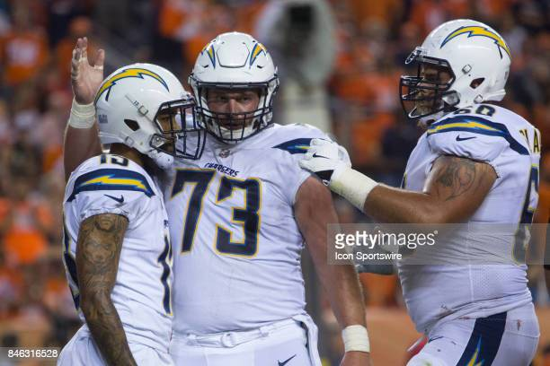 Los Angeles Chargers receiver Keenan Allen celebrates with lineman Spencer Pulley and Matt Slauson during the Los Angeles Chargers vs Denver Broncos...