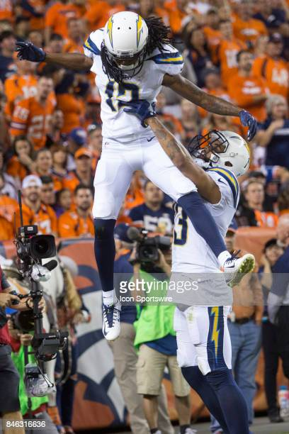 Los Angeles Chargers receiver Travis Benjamin is lifted into the air by teammate Keenan Allen after scoring a touchdown during the Los Angeles...
