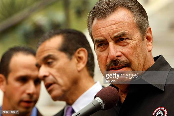 Los Angeles Chief of Police Charlie Beck right with Mayor Antonio Villaraigosa center and City Councilmember Mitch Englander left addresses questions...