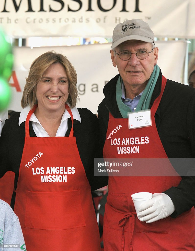 Los Angeles City Controller Wendy Greuel (L) and actor <a gi-track='captionPersonalityLinkClicked' href=/galleries/search?phrase=Harrison+Ford+-+Actor+-+Born+1942&family=editorial&specificpeople=11508906 ng-click='$event.stopPropagation()'>Harrison Ford</a> pose during the Los Angeles Mission Christmas Eve meal for the homeless at Los Angeles Mission on December 24, 2012 in Los Angeles, California.