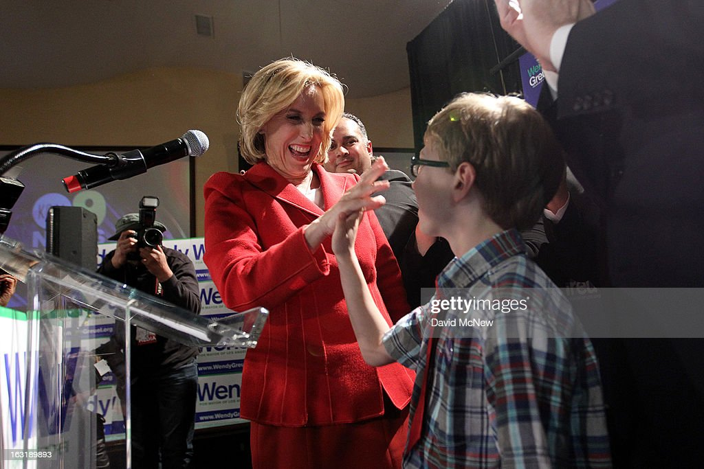 Los Angeles City Controller Wendy Greuel exchanges hands slaps with with her son Thomas as she addresses supporters on Los Angeles mayoral primary night on March 5, 2013 in Los Angeles, California. Greuel and Councilman Eric Garcetti have been locked in a close tie for the lead in the election to replace two-time mayor Antonio Villaraigosa. The top two vote getters of five candidates will face each other in a run-off election in May.