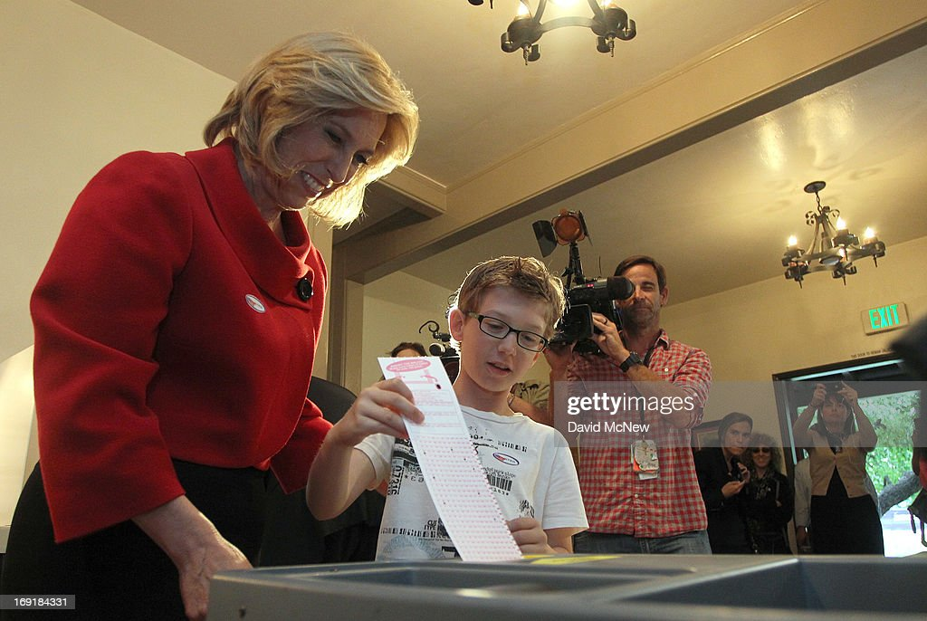 Los Angeles City Controller Wendy Greuel (L) votes, with her son Thomas Schramm placing her ballot into the ballot box, in her Los Angeles mayoral run-off election against Councilman Eric Garcetti on May 21, 2013 in Los Angeles, California. Greuel could become the first-ever woman mayor of Los Angeles in her bid to replace two-time mayor Antonio Villaraigosa.