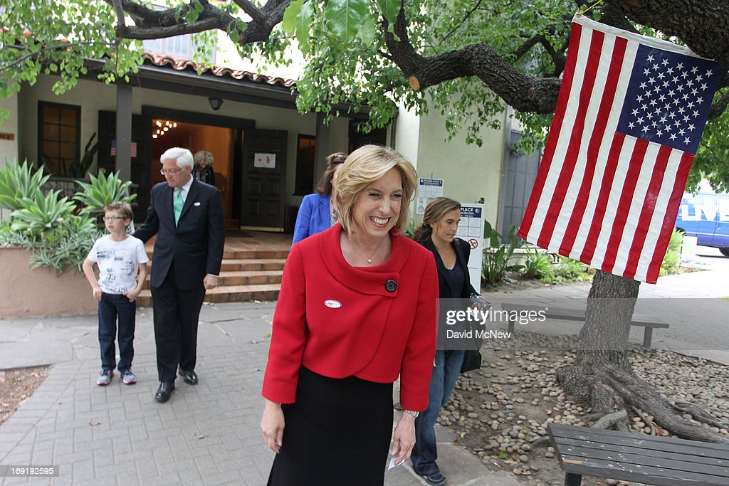 Los Angeles City Controller Wendy Greuel (2R) walks from her polling place with her her son Thomas Schramm (L) and husband Dean Schramm (2L) after voting in her Los Angeles mayoral run-off election against Councilman Eric Garcetti on May 21, 2013 in Los Angeles, California. Greuel could become the first-ever woman mayor of Los Angeles in her bid to replace two-time mayor Antonio Villaraigosa.