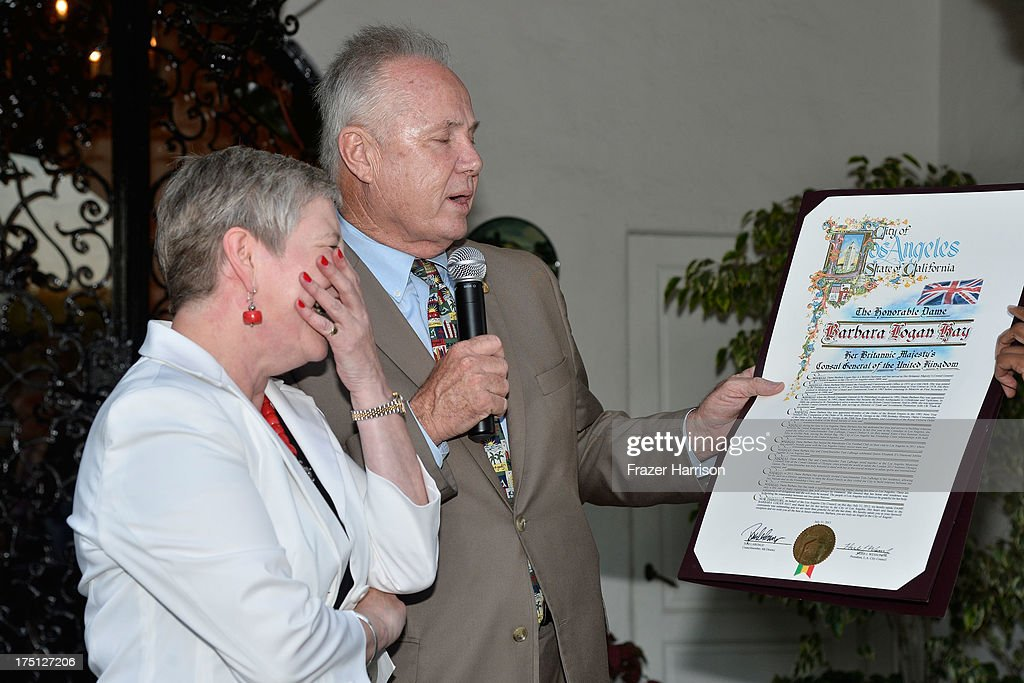 Los Angeles City Councilman Tom Labonge (right) presents the British Consul-General Dame Barbara Hay with certificate for her years of service in Los Angeles at a farewell Cocktail Reception For The British Consul-General Dame Barbara Hay on July 31, 2013 in Los Angeles, California.