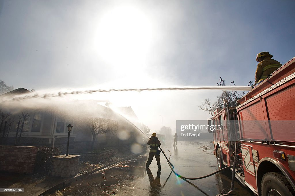 Los Angeles City Fire Fighters Battle The Flames On A Mobile Home In